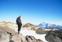 Woman admiring mountains in remote landscape on Mt Baker, Washington, USA — стокове фото