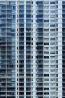 Balconies and windows on modern apartment building — Stock Photo