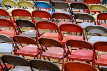 Multicolored empty folding chairs, full frame — Stock Photo