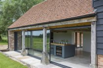 Glass sliding door of converted barn home — Stock Photo