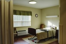 Empty patient room in assisted living facility — стокове фото