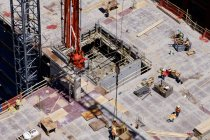 Aerial view of workers at construction site — Stock Photo