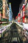 Tokyo city street signs illuminating at night, Tokyo, Japan — Stock Photo