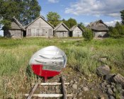 Boat and fisherman sheds in grassy country, Altja fishing village, Estonia — стокове фото