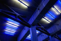 Freeway overpass support structure at night, low angle view — Stock Photo