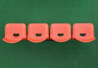 Orange chairs on green carpet, high angle view — Stock Photo