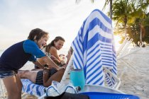 Mother and children enjoying beach at sunset, Grand Cayman Island — Stock Photo
