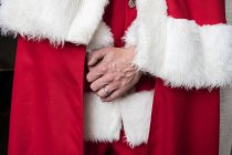 Close-up of hands of man wearing Santa Claus costume. — Stock Photo