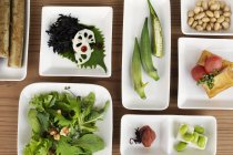High angle close-up of a selection of vegetarian Japanese dishes in a cafe. — Stock Photo