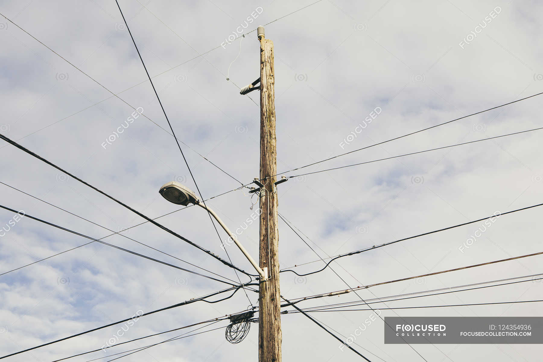 Telephone pole and wires — Stock Photo | #124354936
