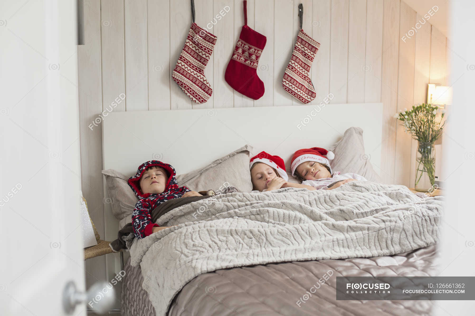 Christmas stockings above children heads. — elementary age ...