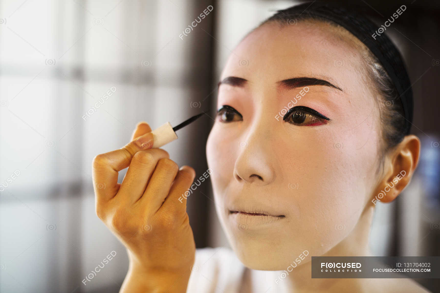 Geisha or maiko with a hair and make up artist — front view, waist up -  Stock Photo | #131704002