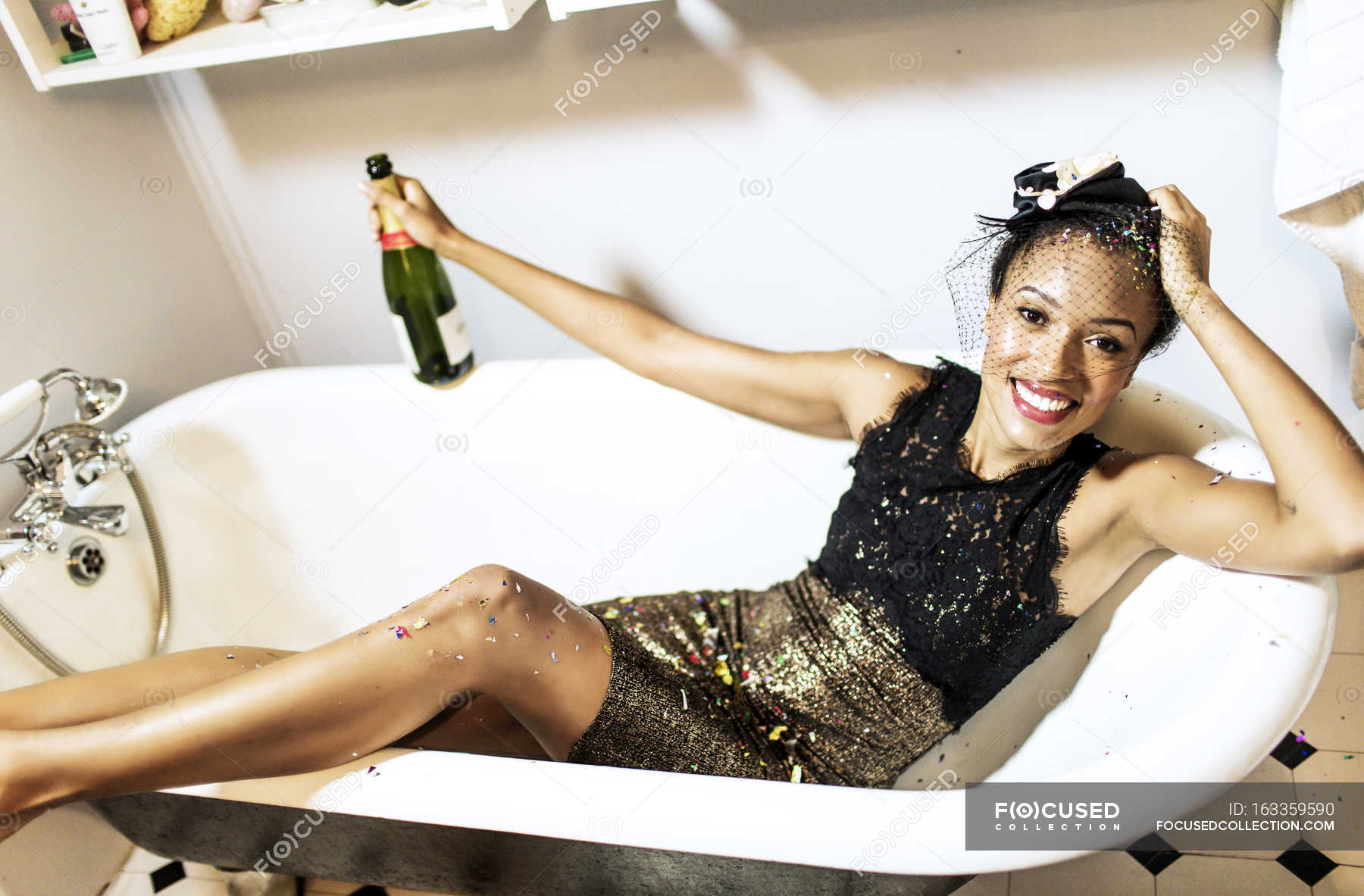 Woman Sitting In Bath With Champagne Bottle Container Energy Stock Photo 163359590