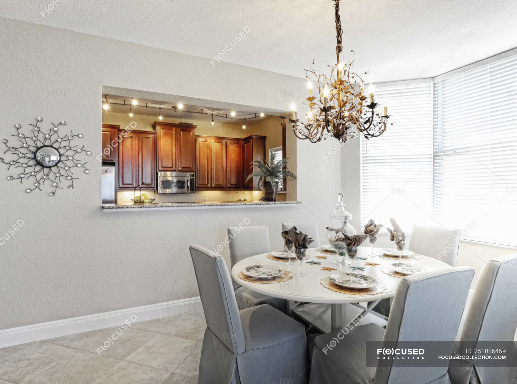 Chandelier Over Dining Room Table In, Upscale Dining Room Tables