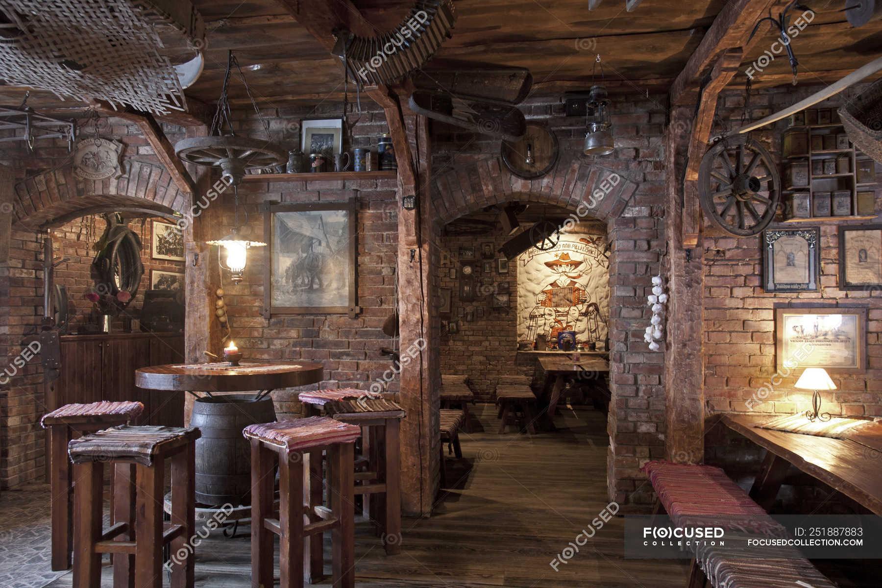 Rustic Restaurant Seating With Brick Walls And Classic Decor Estonia Memorabilia Stock Photo 251887883
