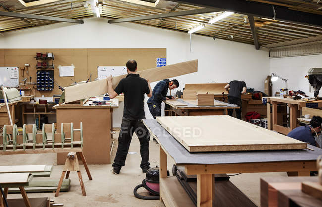 Two men working with wood — Stock Photo