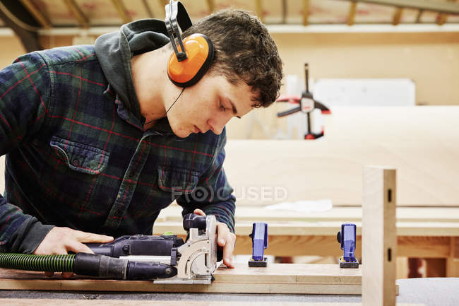 Young man using tools — Stock Photo