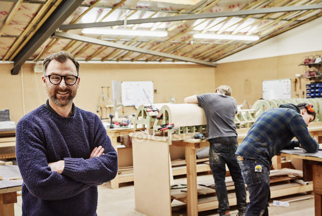 People working  in furniture workshop — Stock Photo