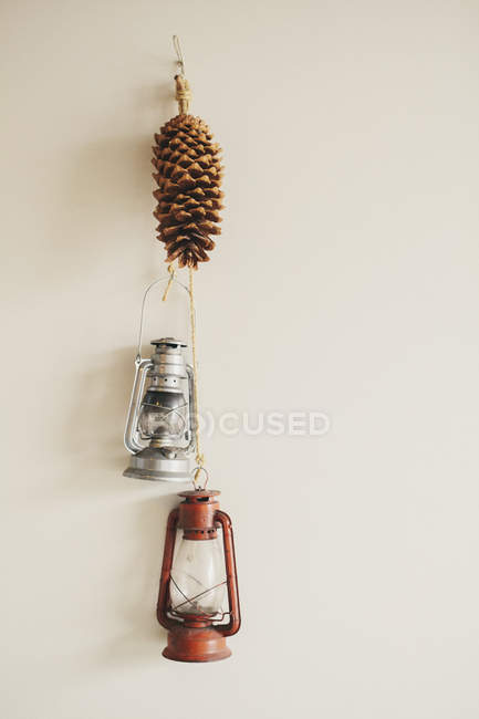 Two hurrican lamps on a wall. — Stock Photo