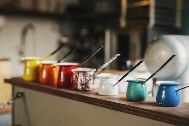 Group of enamel jugs — Stock Photo