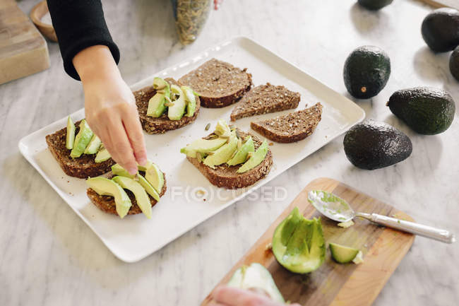 Woman preparing open sandwiches — Stock Photo