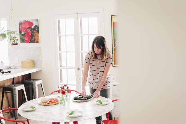 Woman laying a table — Stock Photo