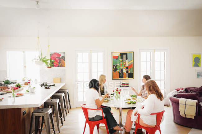 Four women friends having lunch. — Stock Photo