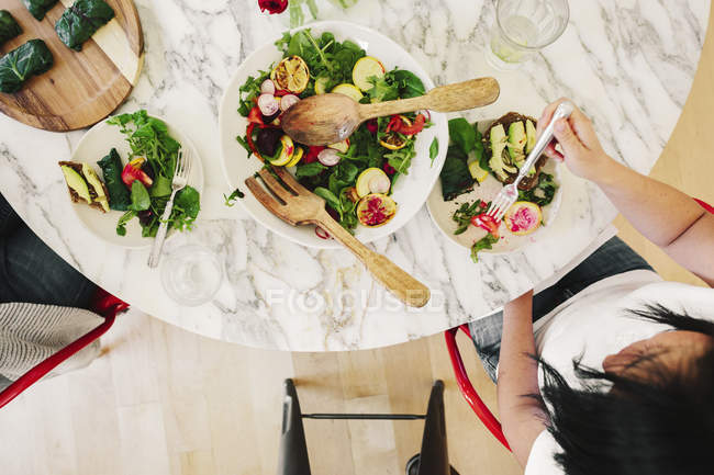 View from above of a table laid with cutlery — Stock Photo