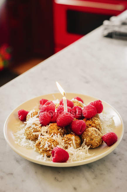 Plate with a dessert and fresh raspberries — Stock Photo