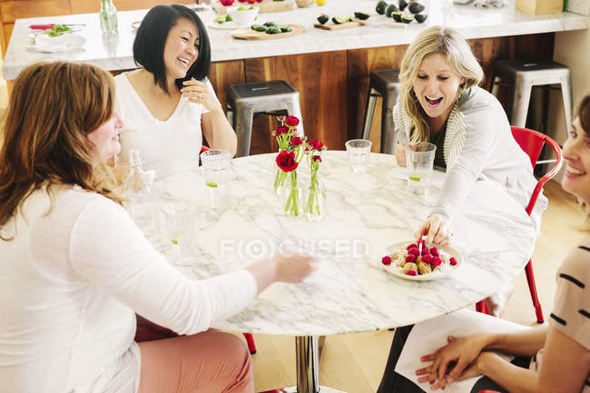 Four friends around a table — Stock Photo