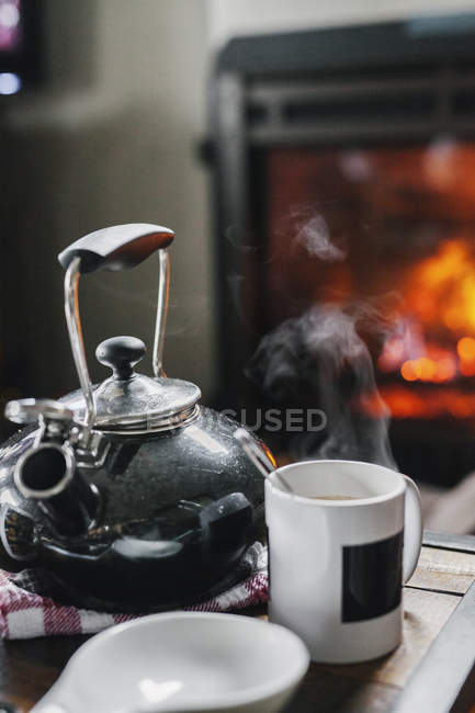 Teapot and coffee on the table — Stock Photo