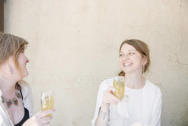 Women holding glasses of champagne. — Stock Photo