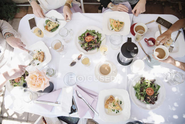 High angle view of four women sitting round a table — Stock Photo