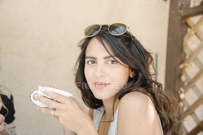 Woman holding a cup. — Stock Photo