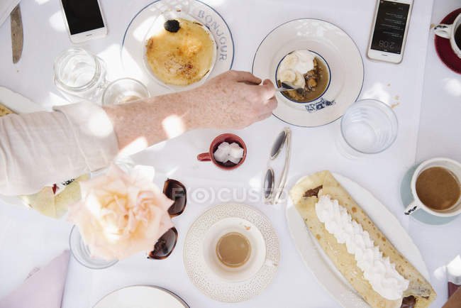 High angle view of a table with food and drink — Stock Photo