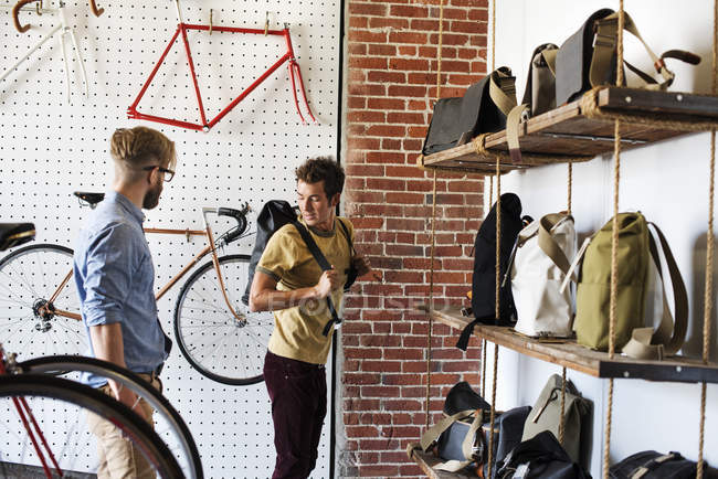Man in a cycle repair shop — Stock Photo