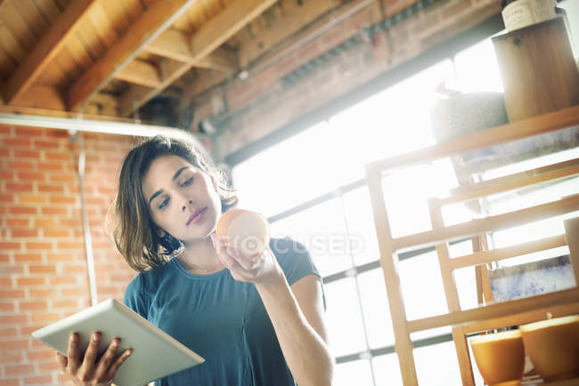Young woman in a shop — Stock Photo