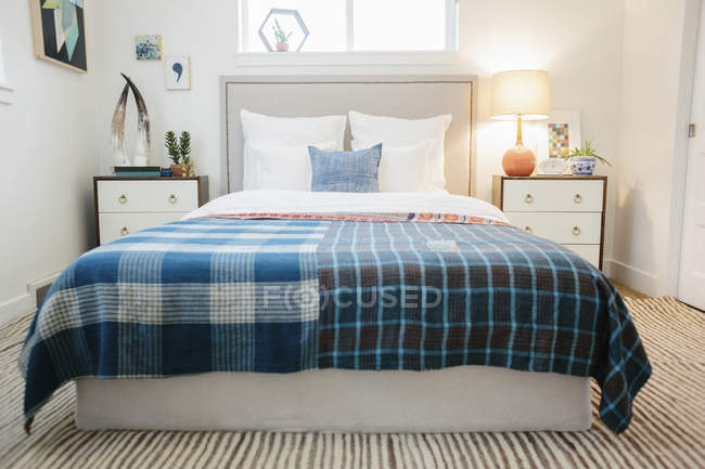Bedroom in an apartment with a double bed — Stock Photo