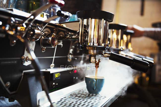 Coffee machine making coffee — Stock Photo