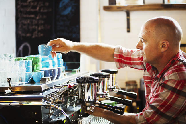 Man working a coffee machine — Stock Photo