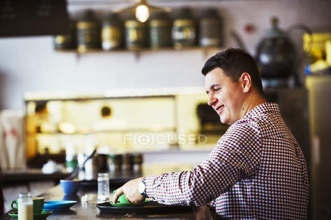 Man seated at a counter — Stock Photo