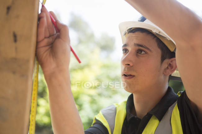 Construction worker wearing high visibility vest — Stock Photo