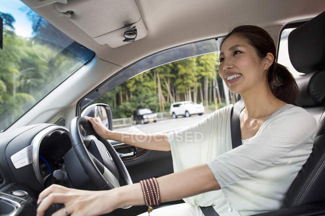 Woman sitting in her car. — Stock Photo