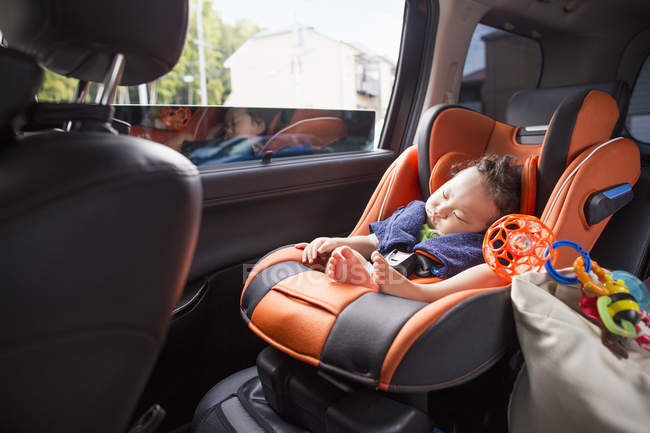 Asian baby sleeping in the car. — Stock Photo