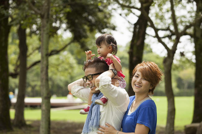 Two japanese parents and a toddler. — Stock Photo