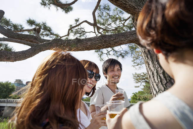 Group of friends in the park — Stock Photo