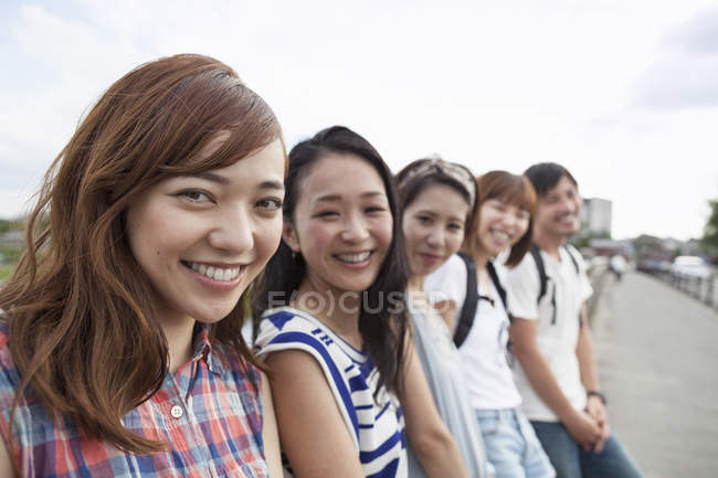 Group of japanese friends in the park — Stock Photo