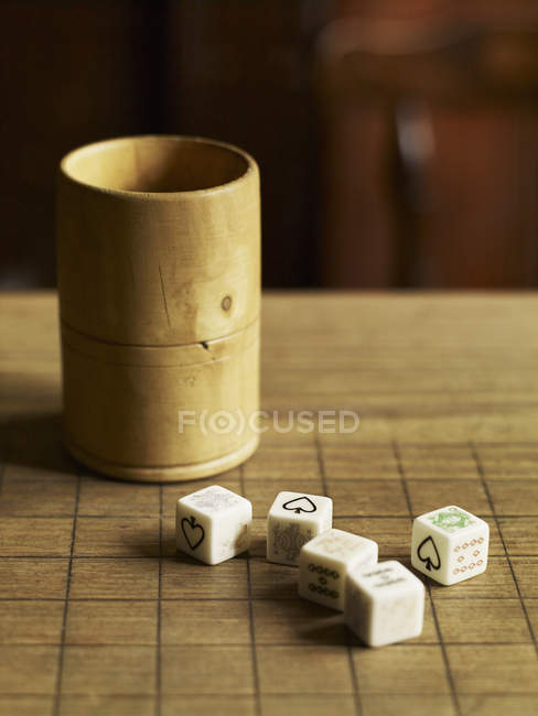 Five dice with printed faces — Stock Photo