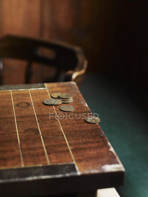 Pub games table with copper coins — Stock Photo