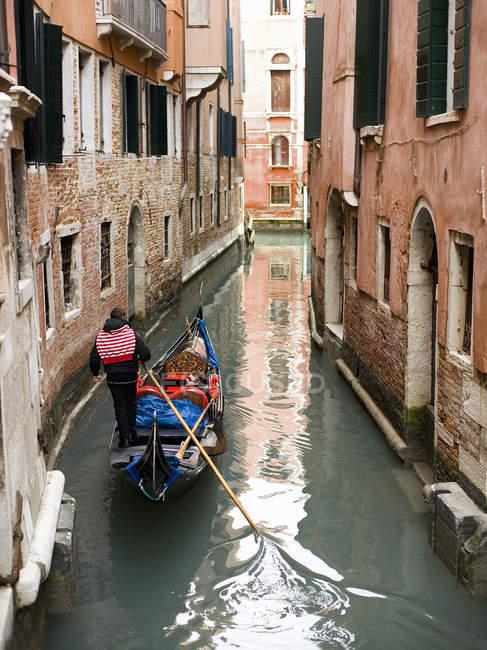 Gondola boat gliding down — Stock Photo
